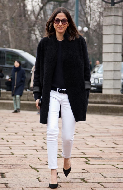 LE FASHION BLOG PARIS FASHION WEEK PFW STREET STYLE VOGUE PARIS MARKET EDITOR CAPUCINE SAFYURTLU BLACK SHEARLING LEATHER COAT TEE TSHIRT SKINNY WHITE JEANS DENIM BLACK SUEDE HEELS PUMPS via Vogue Australia