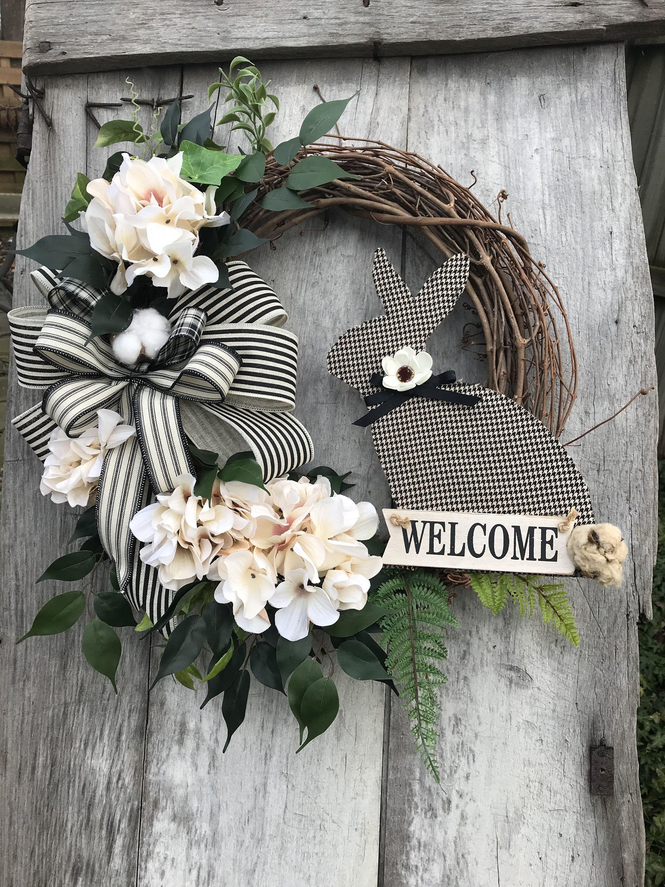 Photo of Spring farmhouse with black and ivory plaid and striped bow, Easter wreaths, rabbit wreath for the front door, rabbit wreath for the door, farmhouse