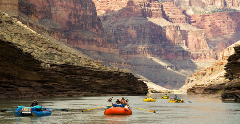 ARIZONA: Grand Canyon River Rafting. Experiencing the Colorado River by raft while looking at the canyon's rising heights makes for an amazing experience.