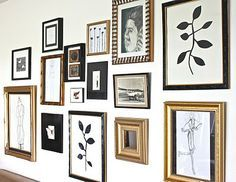 Black And Gold Wall Art gallery wall.white frames mixed with gold frames and