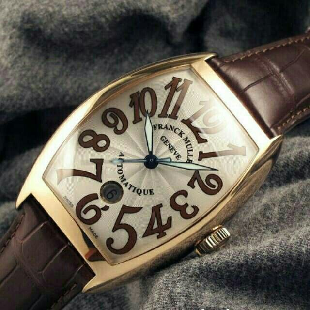 Franck Muller - Casablanca 8880RG (New in Box)  Model : Franck Muller Type : Casablanca Material : 18K Rosegold Strap : Alligator brown leather strap with 18K RG buckle Machine : Frank Muller Caliber 2800, & Automatic Movement  Size : 40 mm x 55 mm Dial Color : Silver Guilloche with hand-painted Brown Arabic numerals  Water Resistant : 30 m / 100 ft Reference No : 8880BCDT  Note : Cimplete Box & Paper. Condition : New in Box / Never used  Price : idr 140.000.000