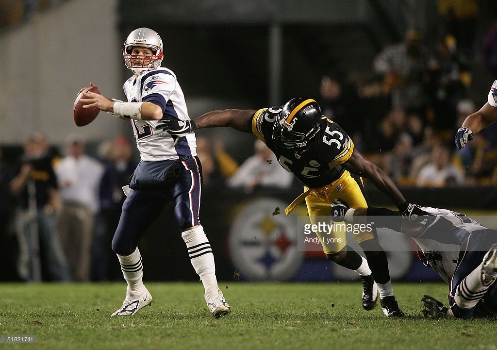 28f368ea0a8 Quarterback Tom Brady  12 of the New England Patriots attempts to pass the  ball before being sacked by outside linebacker Joey Porter  55 of the  Pittsburgh ...