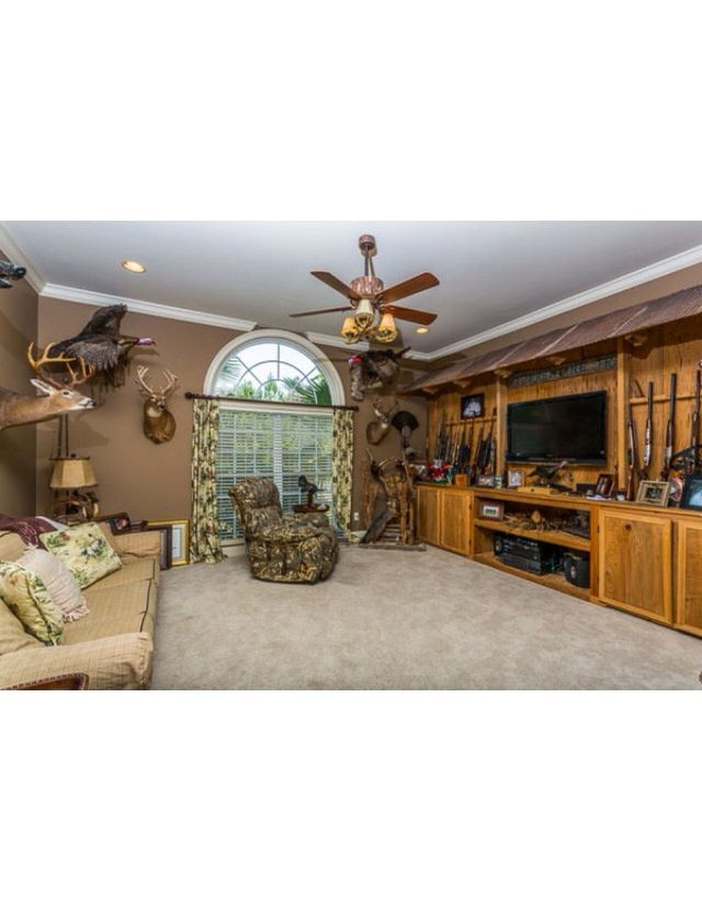 Gun rack/display and entertainment center - I'd love to find one of these for my house!