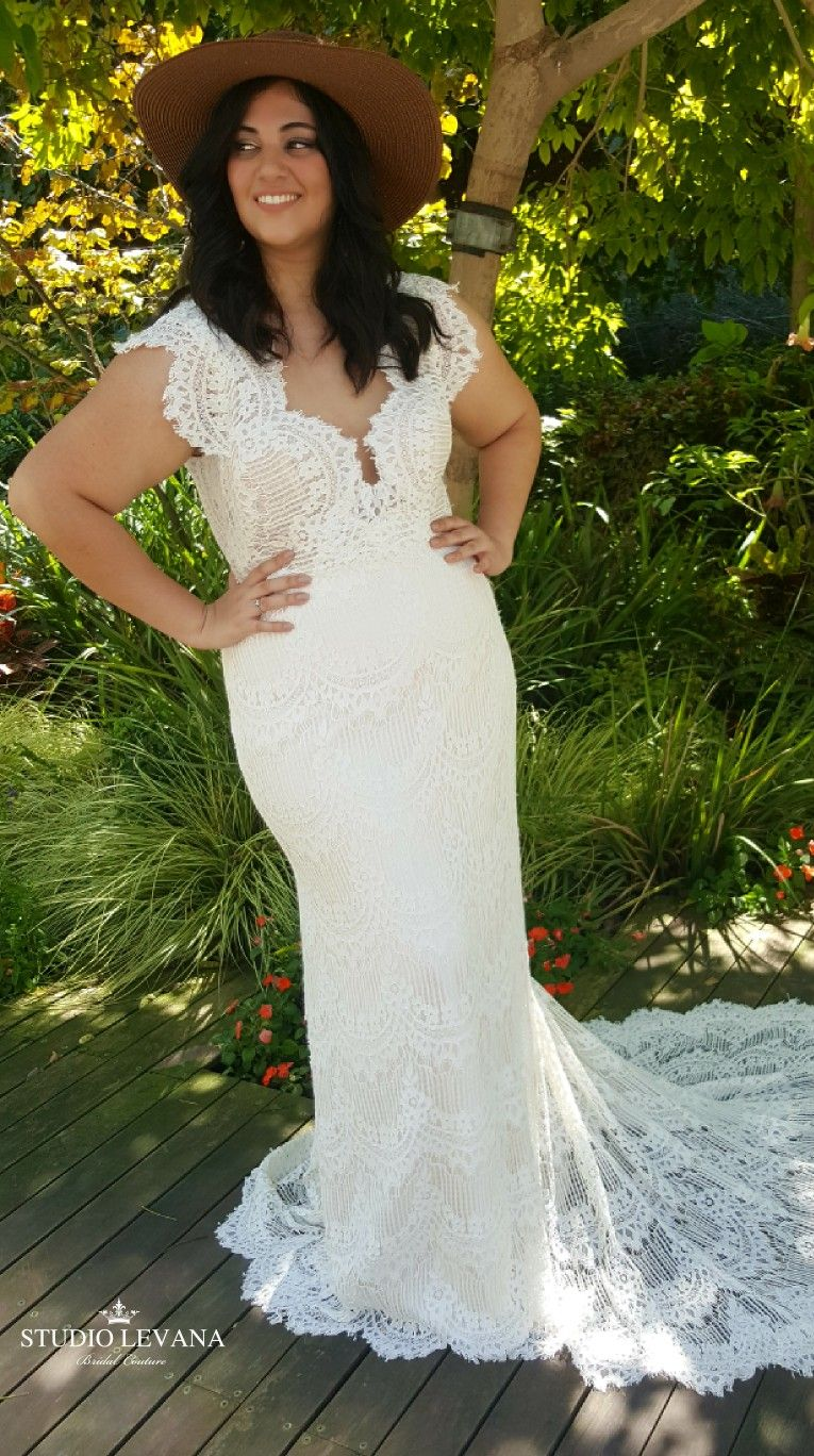 Bohemian curvy wedding gown with unique sleeves, made from