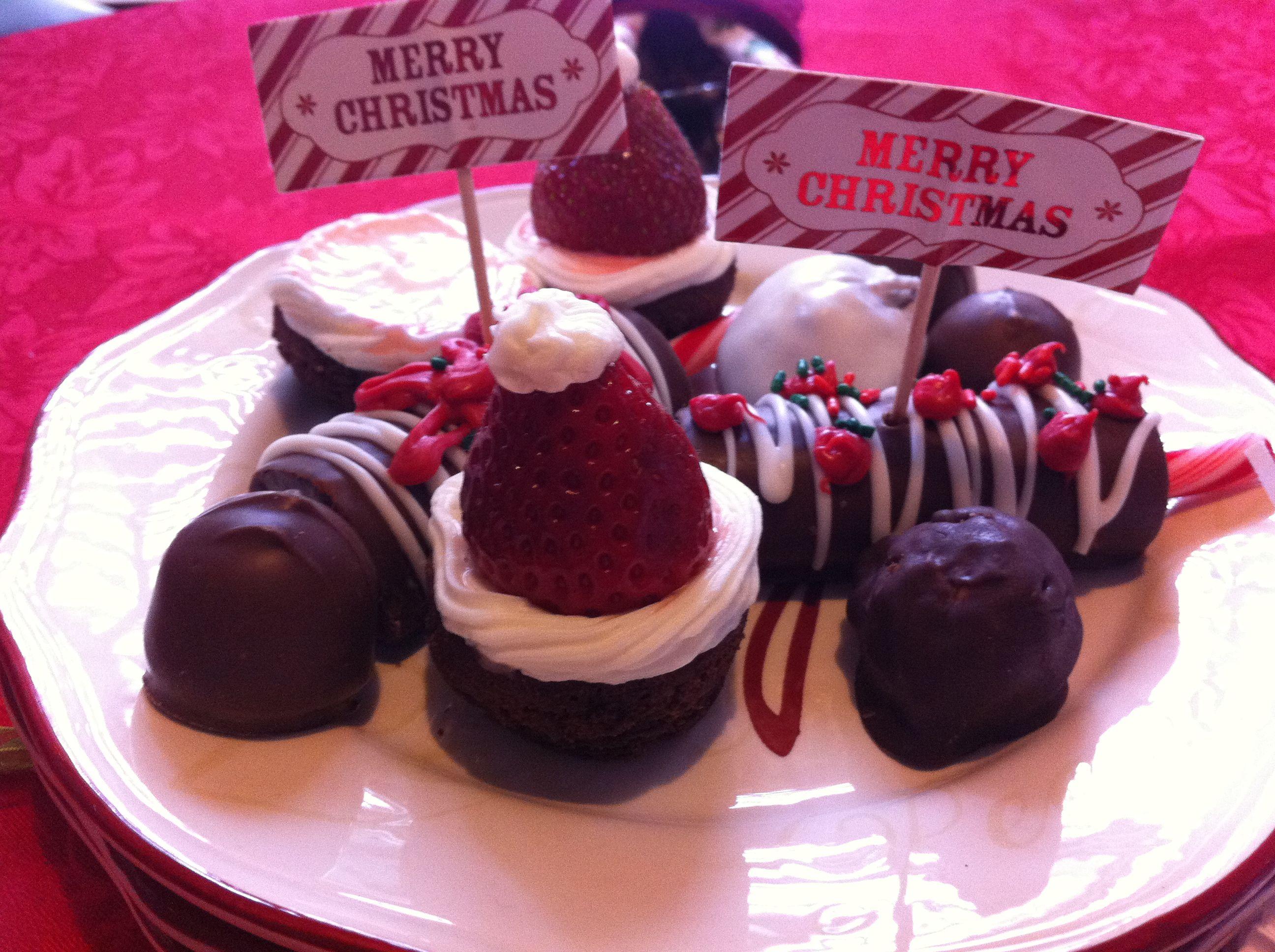 Santa Brownie hats, decorated swiss rolls, chocolate covered cherries, pb balls 2011 Christmas dinner treats