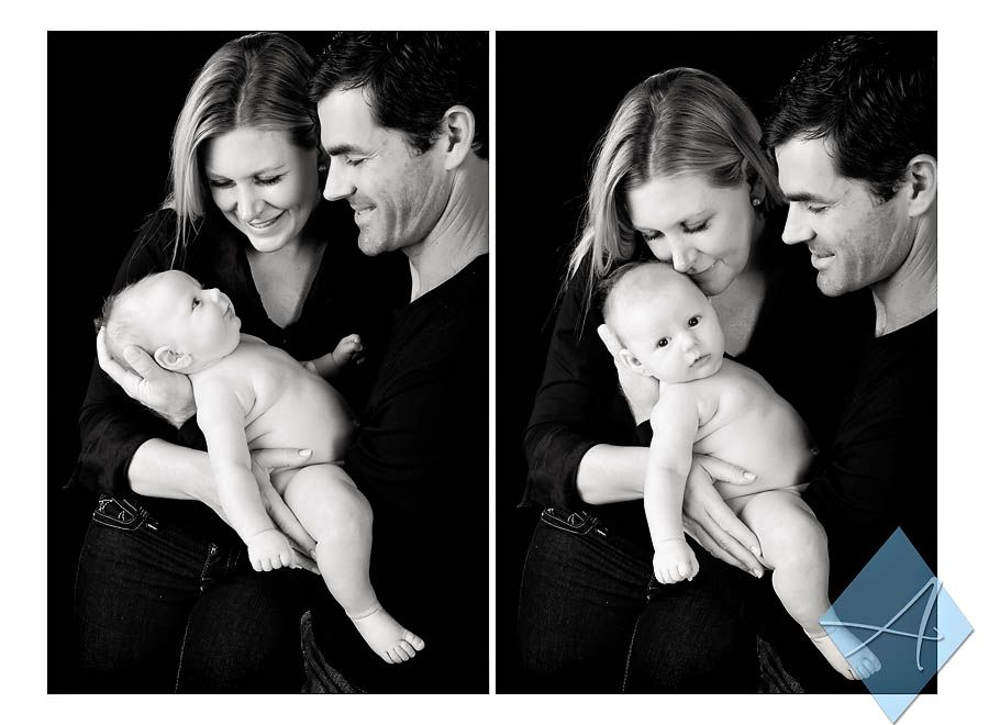 Newborn Family Photos Over Black Backdrop