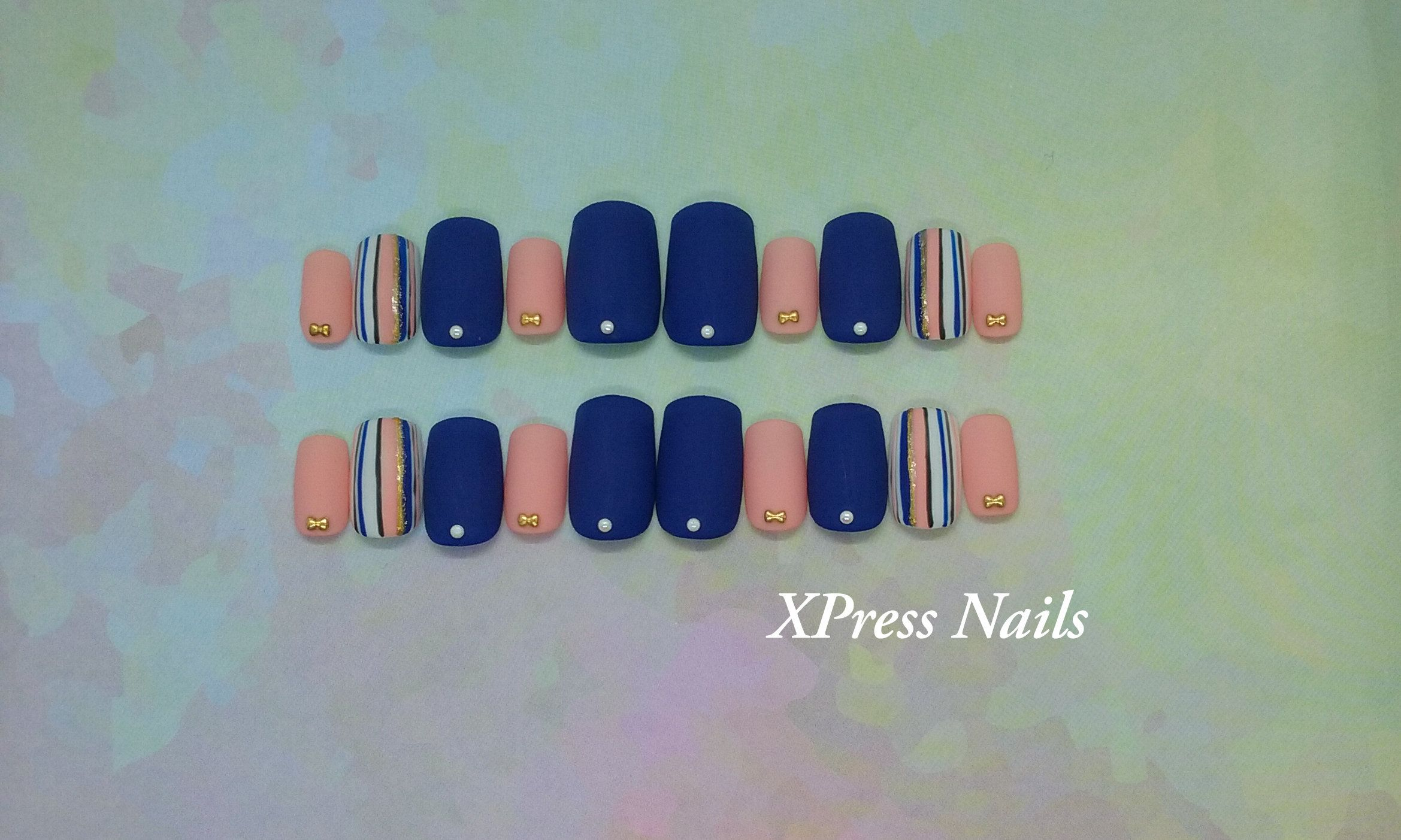Matte Press On Nails In Navy Blue And Peach With Striped Accent Nails And Decorations Fake Nails Xpress Nails Press On Nails Nails Accent Nails