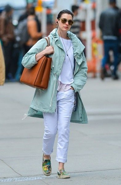 Anne Hathaway stepped out in New York City dressed down in a mint-green windbreaker.