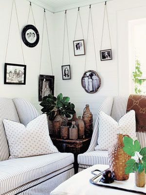 Notice how the accessories give character to this space- hanging photos, vintage jugs.
