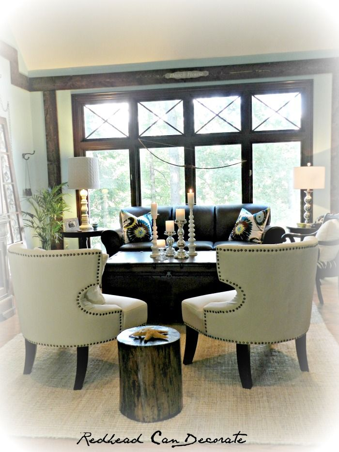 How we transformed our dark living room on a budget.  Includes how we made the stump end table from a dead stump in our yard, how to put x moldings in your window, how we put trim around our window like you see in Pottery Barn.