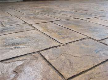 A Close Up Of The Marigold Roman Ashlar Slate And Tan Release Powder Patio Stamped Concrete Patio Stamped Concrete Patio Designs Concrete Stain Patio