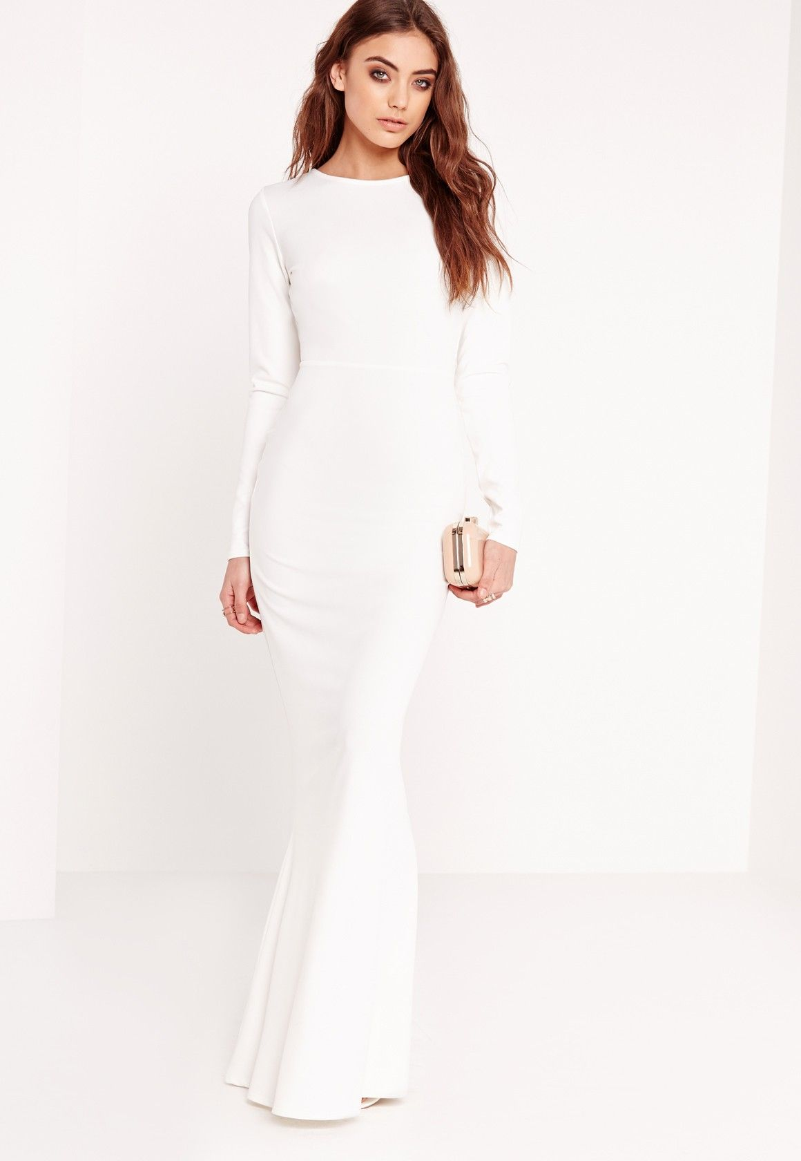 e247e6efec2 We re totally girl crushin on this long sleeve maxi dress in a sexy white  shade. With an open back finish