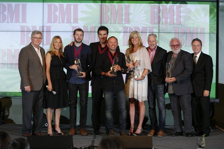 The team behind the BMI 2014 Christian Song of the Year accepts their award. Pictured are (l-r): BMI's Phil Graham and Leslie Roberts; songwriters Scott Cash; Ed Cash; and Chris Tomlin; sixsteps Songs's Shelley and Louie Giglio; Capitol CMG Music Publishing's Eddie DeGarmo; and BMI's Jody Williams. (Photo by John Russell)