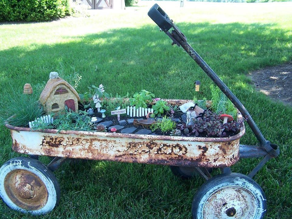 fairy garden in an old wagon
