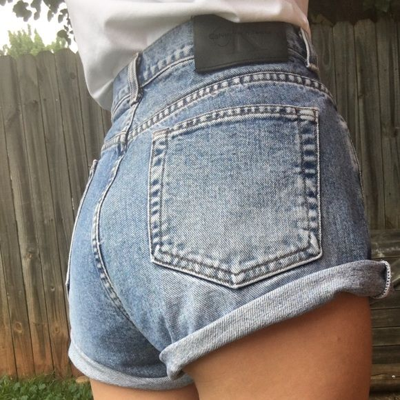 Calvin Klein high waisted shorts Vintage Calvin Klein high waisted denim shorts in excellent condition. These are buckle up and the waist measures 30 inches Calvin Klein Shorts Jean Shorts