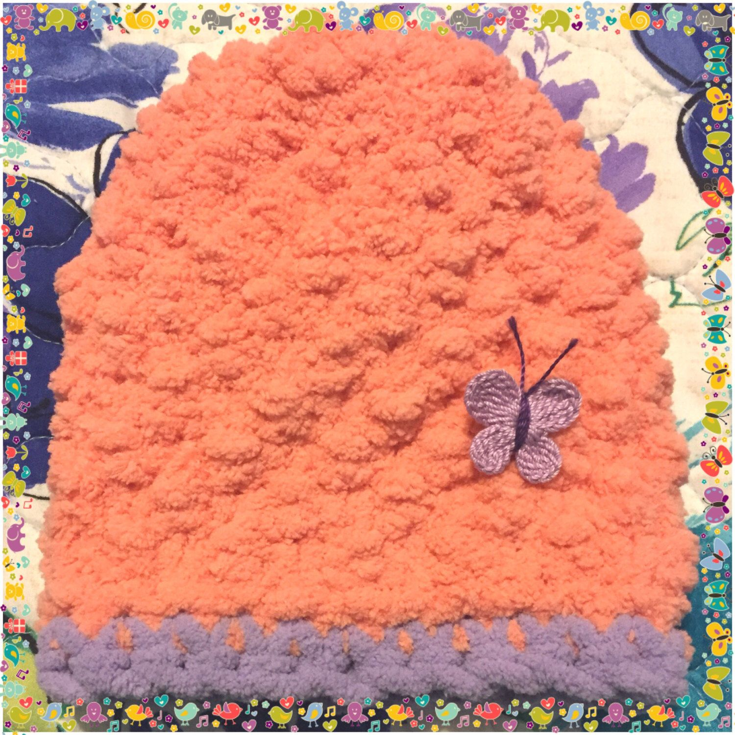 A personal favorite from my Etsy shop https://www.etsy.com/listing/470468824/butterfly-baby-peach-lavender-hand-knit