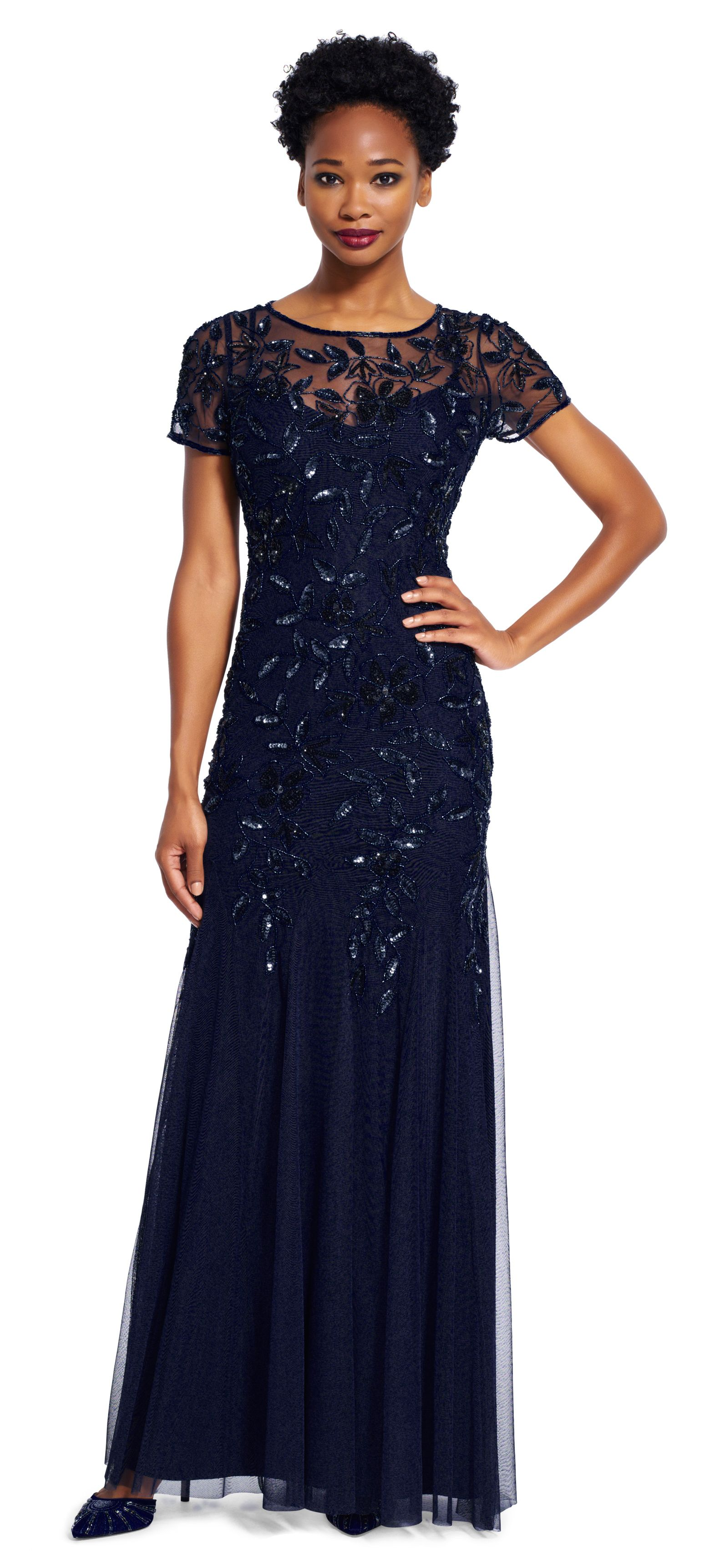 This truly glamorous gown features a delicately beaded floral ...