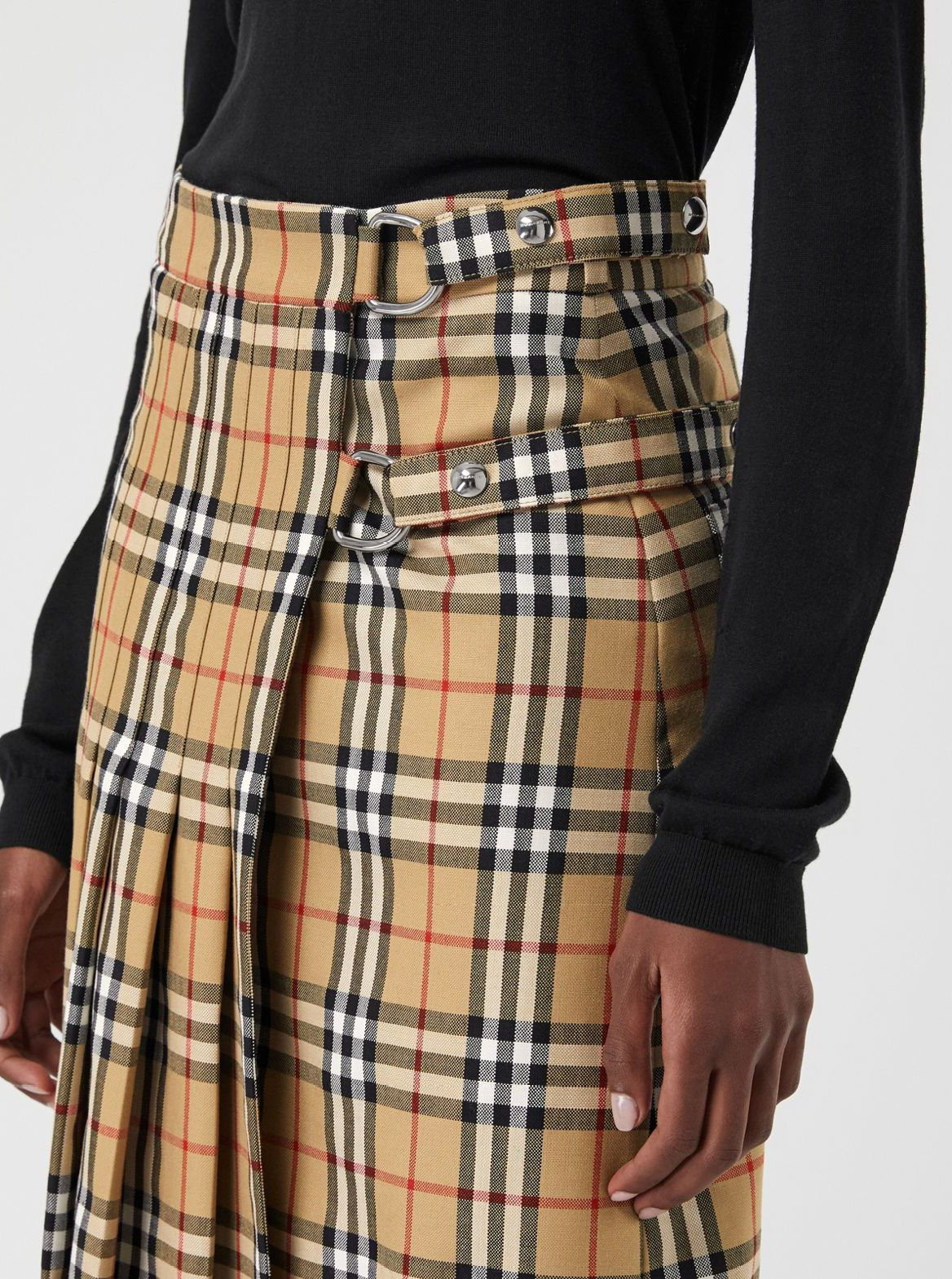 1689d8206197 A longline kilt clad in #Burberry Vintage check wool with trench-inspired  D-ring strap closures
