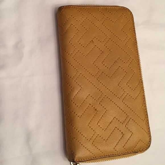Tory Burch wallet Authentic! Some discoloration around edges. See pics otherwise in good condition . Inside of wallet in perfect condition. Kind of a dark yellow, mustard color Tory Burch Bags Wallets