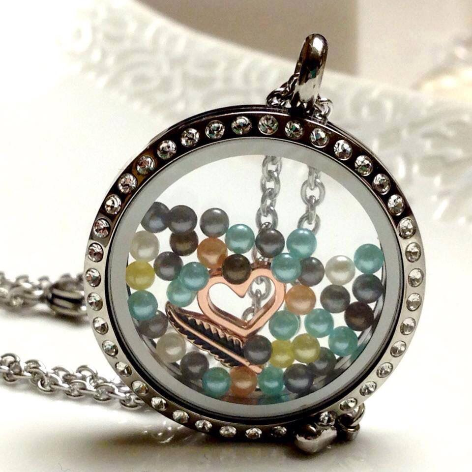 Beautiful locket filled with love. Love the pearls  Www.southhilldesigns.com/elisamurphy Artist #341232