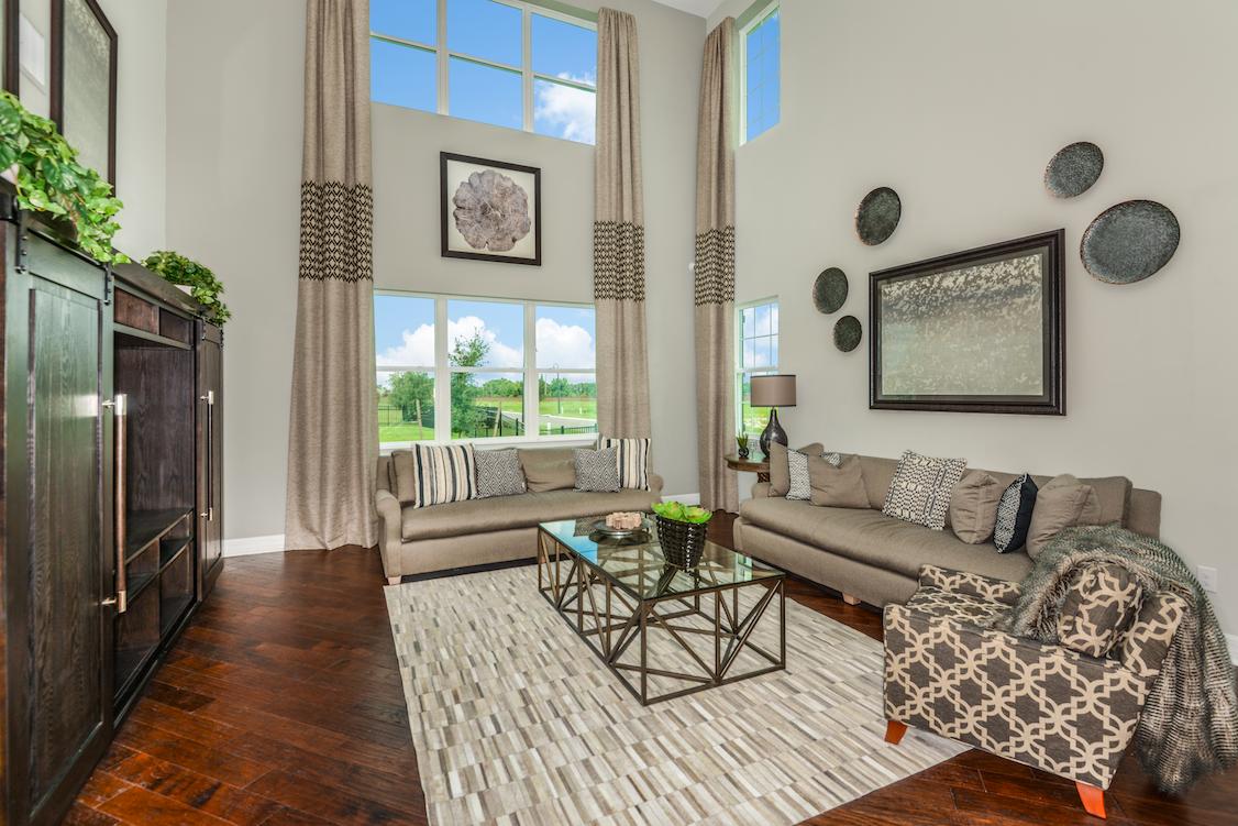 Dark hardwood floors are balanced by extra large windows