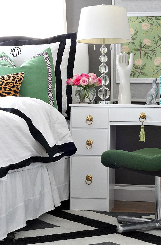 Bedroom design with bold and feminine style in gray, green, pops if pink.