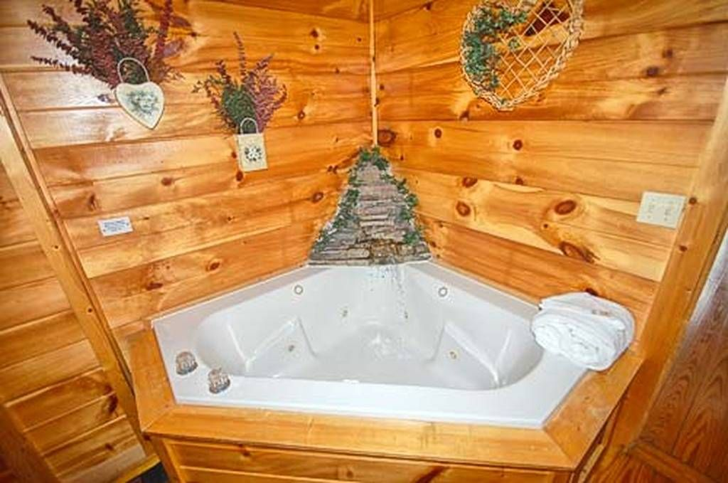 Country Oak Enjoy The Water Fall Feature In The Corner Of The Jacuzzi Tub As You Sit Back And Relax Gatlinburg Cabin Rentals Cabin Rentals Gatlinburg Cabins
