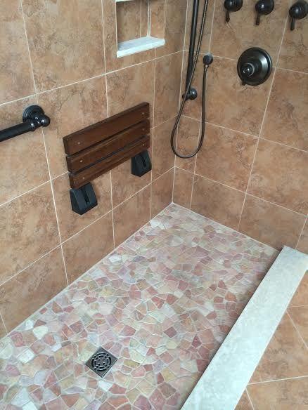 Island Stone Pebble Shower Floor. Porcelain Wall Tile. Kerdi Shower Kit By  Schluter.