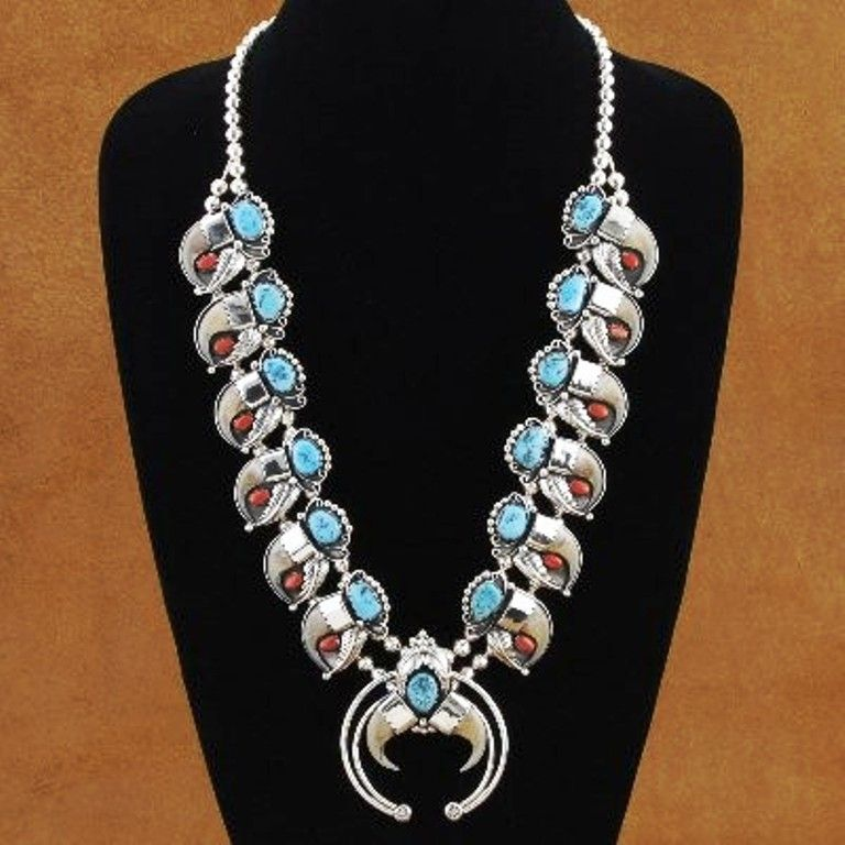 Lynx Claw Sleeping Beauty Turquoise and Coral Sterling Silver Squash Blossom Necklace, http://www.nativeamericanstuff.net/wholesale_bear_claw_necklaces.htm