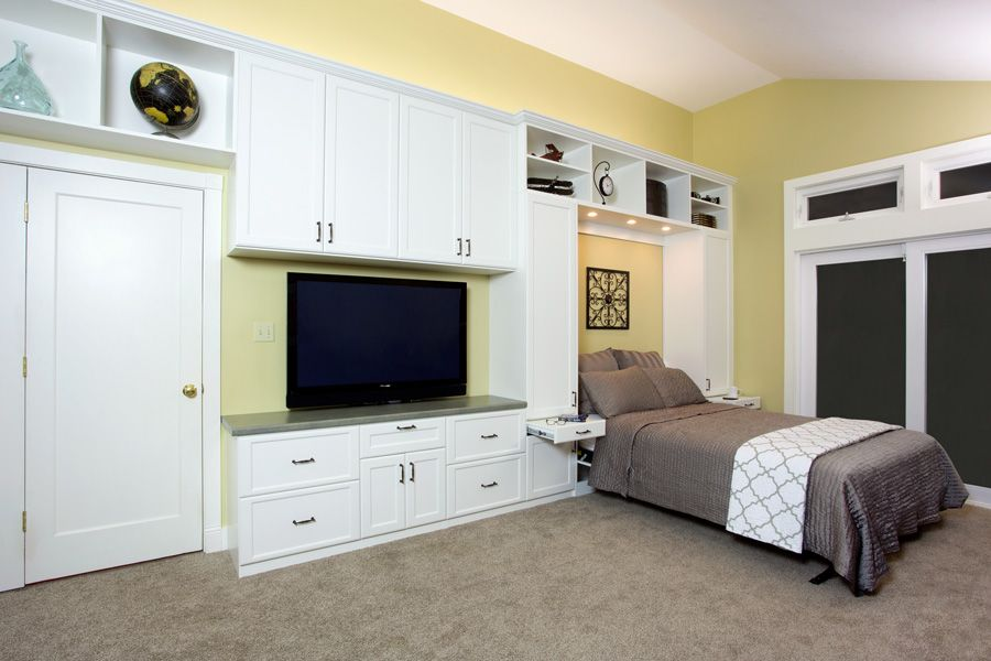 Custom cabinetry and wall beds can transform your living room into a multipurpose space fit for both entertaining and functioning as a guest bedroom.