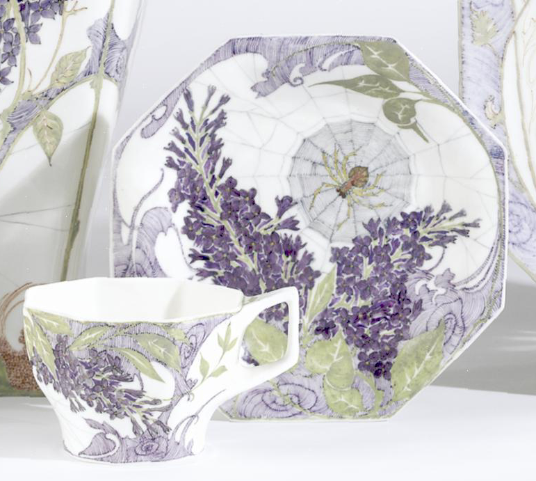 ROZENBURG OCTAGONAL CUP AND SAUCER 1913 by S. Schellink, each piece painted with a spider web and flowering lilac, printed factory mark, painted year code, decorator's mark and work order number 103. Saucer restored. width of saucer 5in. (12.7cm) | SOLD $780 New York 2005