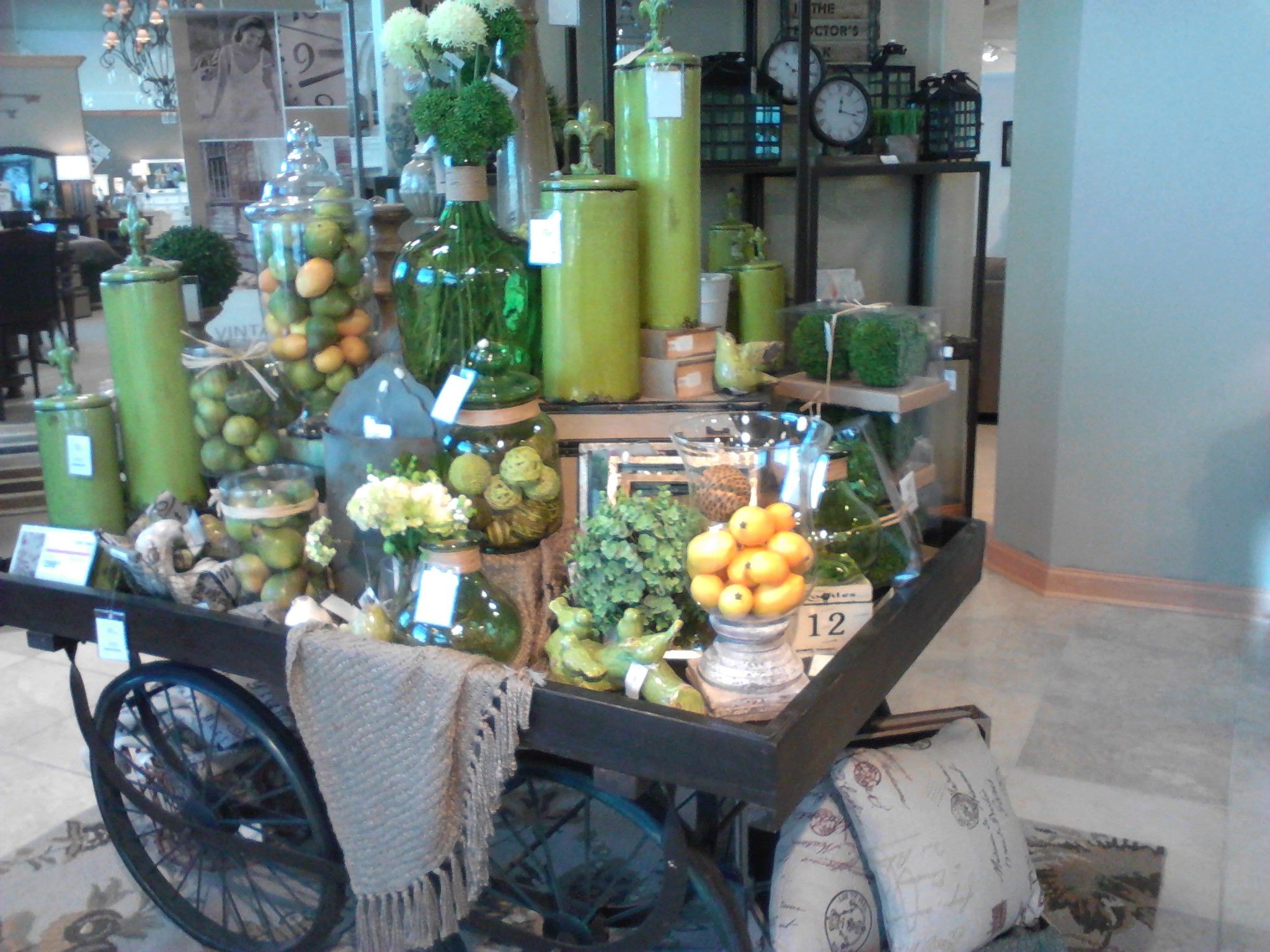 Accent Cart of home goodies.  So many decorating ideas in one cart.  Green and blue work into so many rooms.