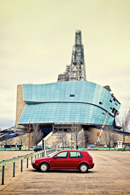 """Red car at CMHR"" Canadian Museum For Human Rights  Winnipeg, MB, CA by AJ Batac"