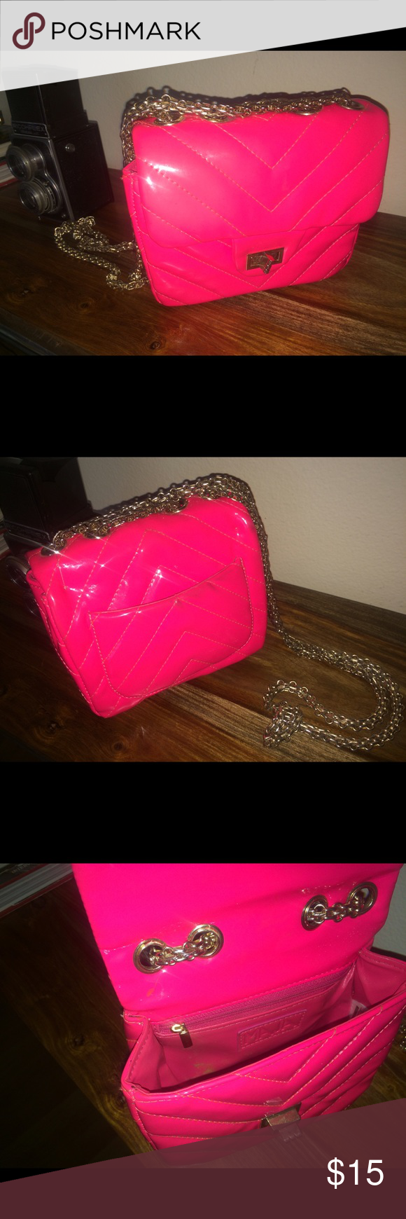 NEON PINK 🌼 CROSS BODY WITH CHAIN Neon pink bag with gold chain. There's a few stains and scruffs along the bag price reflects. Bags Crossbody Bags
