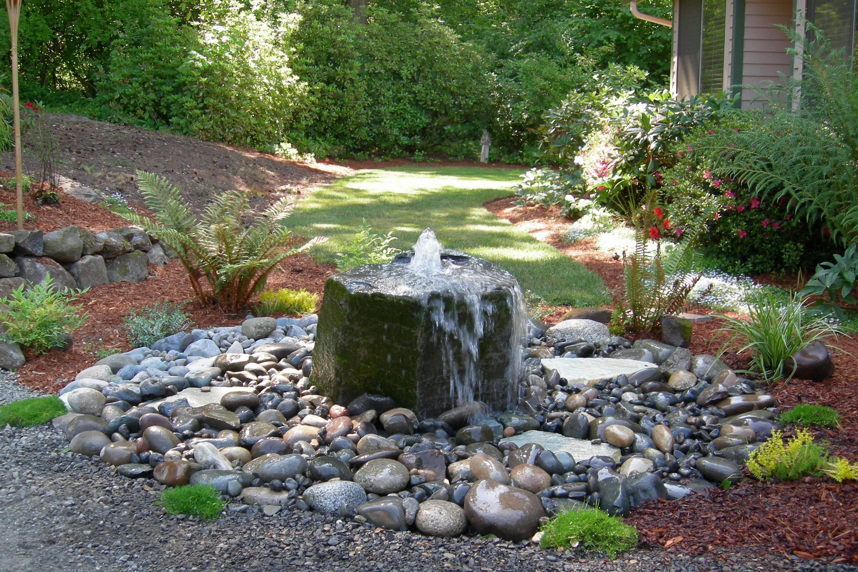 Ideas unique water fountain outdoor fountains for pond for Stone garden waterfall