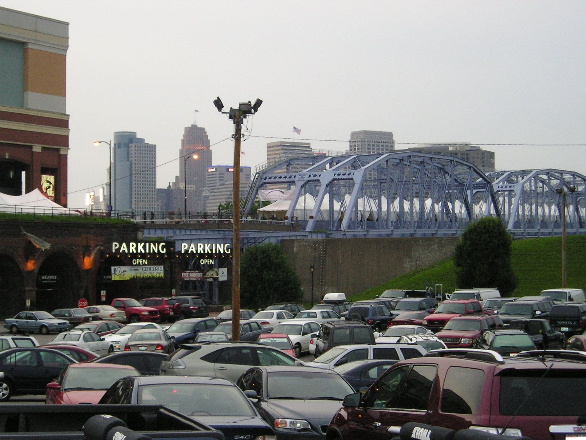 OHIO - At first, this picture of Cincinnati looks ordinary, but take a closer look.  I like the flag in the distance on top of the building.  I think it's also ironic to note the Open Parking signs in a sea of parked cars!