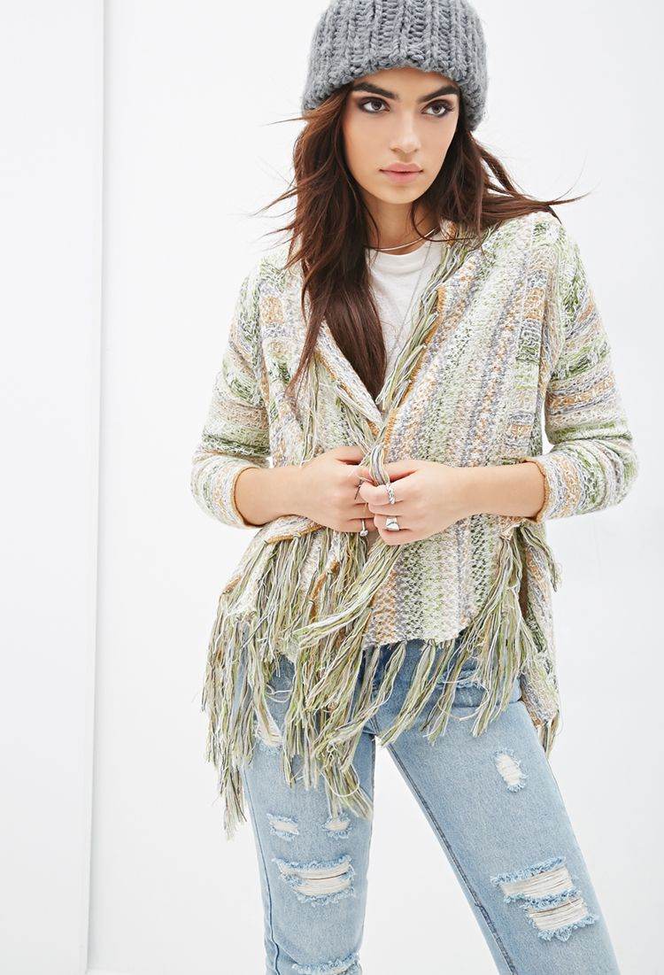 The coziest companion for impromptu beach bonfires and late night hikes, this striped knit cardigan was made for the free-spirited adventurer! It features a relaxed open front with a draped shawl collar and long sleeves. Tasseled fringe accents the collar all the way through the hem for perfect boho vibes.