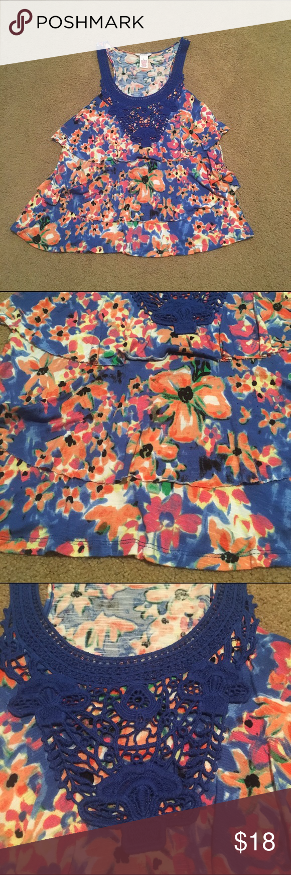 Blue floral lace tank top Blue floral lace tank top. It does have multiple layers as pictured. Very beautiful! Pair it with a cardigan and dress pants or just with jeans and heels! 👠👖maybe worn once so still in great condition! Candie's Tops
