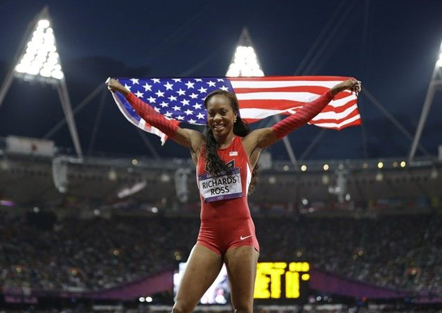 Sanya Richards Ross from the U.S. holds her national flag and celebrates after winning the women's 400-meter final