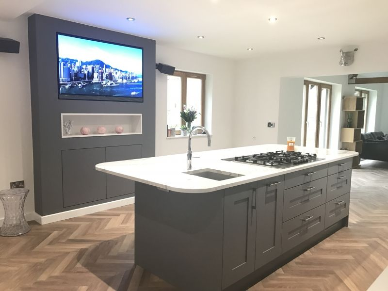 Kitchen Island With Feature Entertainment Backdrop Central Hob And