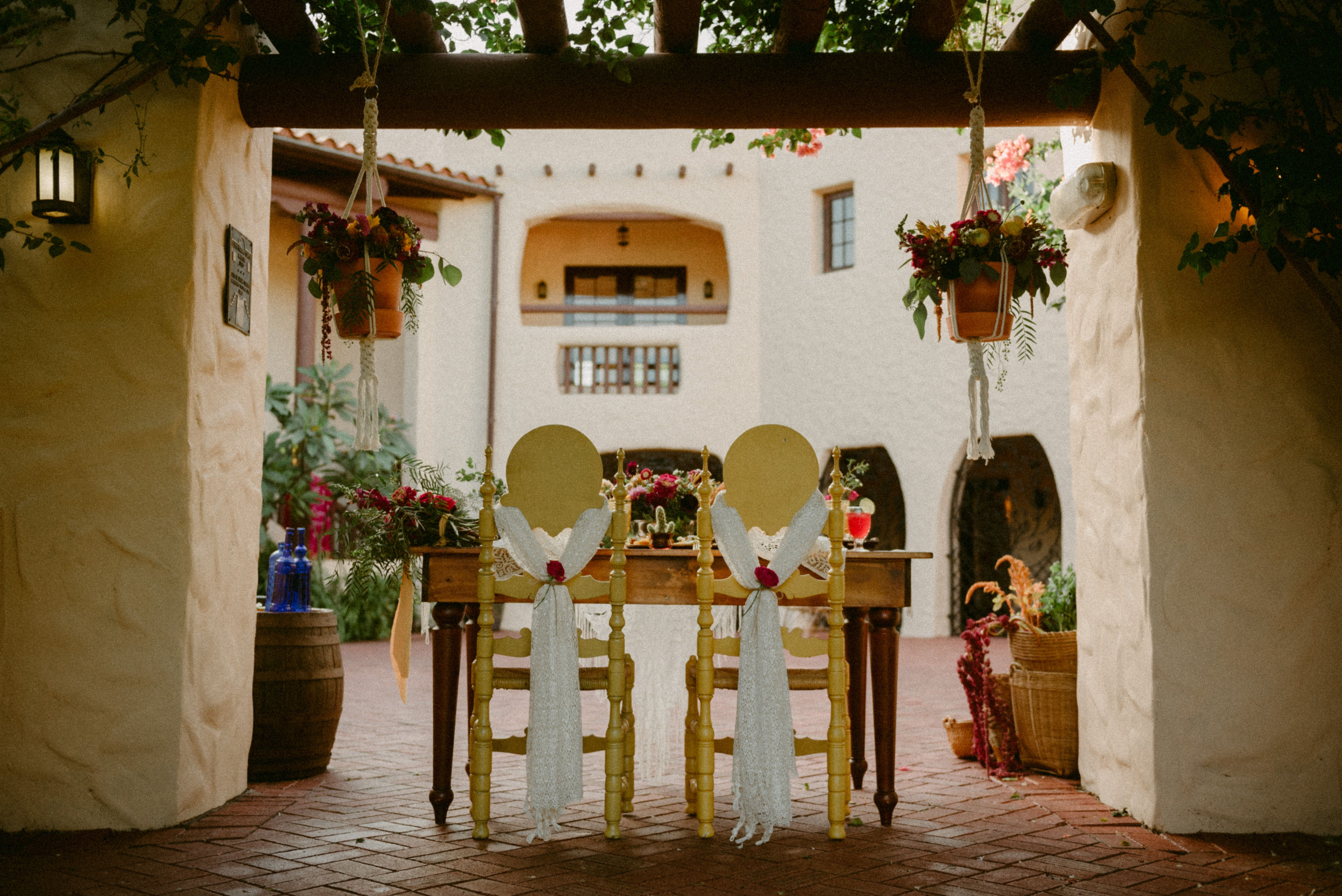 Outdoor wedding ceremony at Curtis Mansion  Spanish style wedding