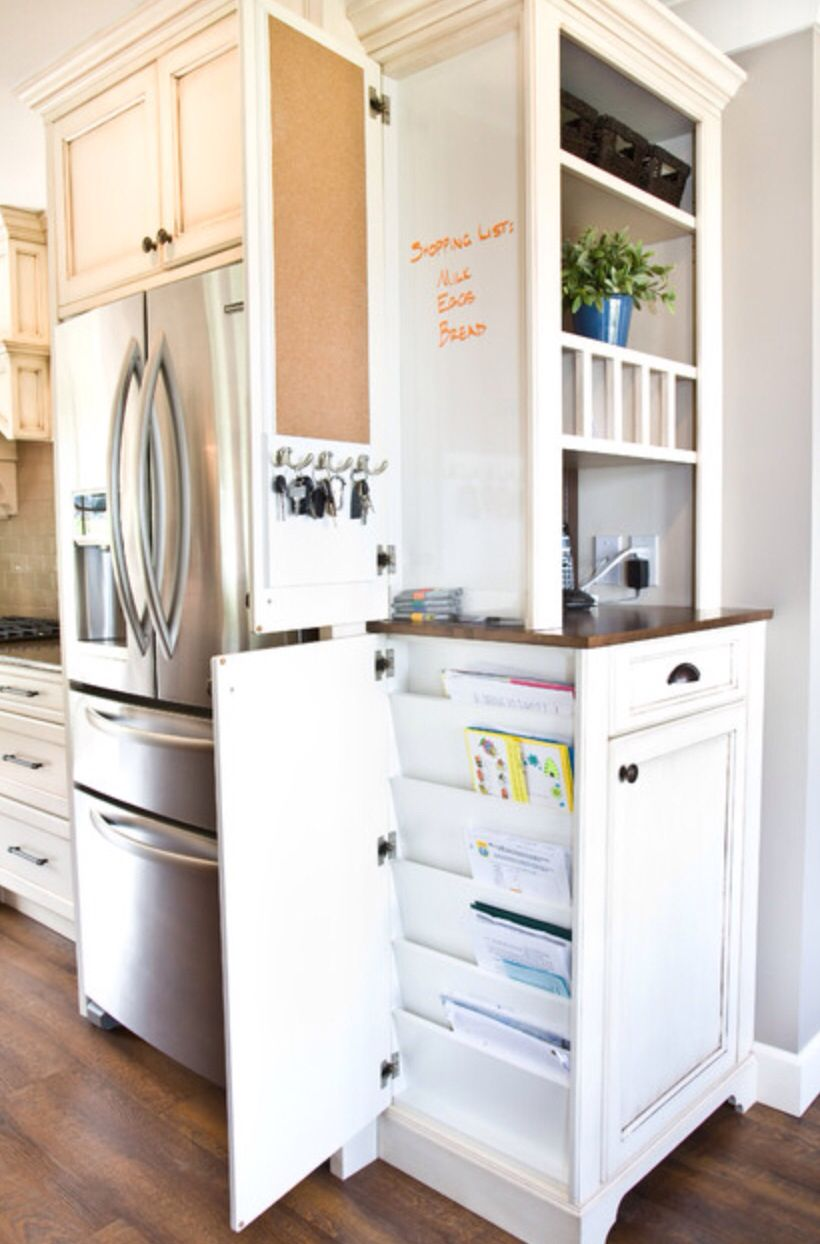 Cabinet beside fridge next to door - napkins, paper plates, grill ...