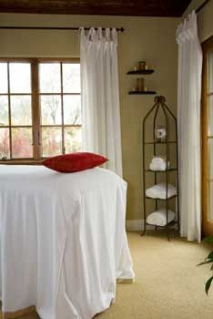 Tie Top Curtains Used In A Massage And Beauty Therapy Room, Hung On Wrought  Iron Curtain Rods Create A Relaxed And Informal Space For Working.