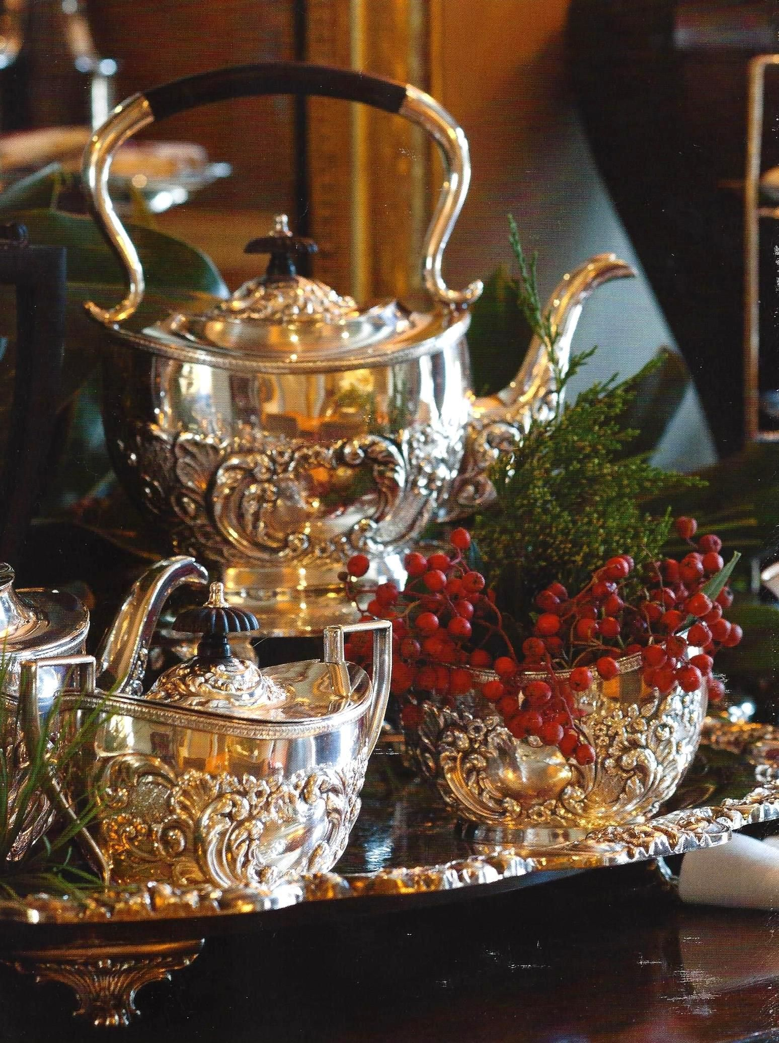 Silver tea service with Christmas greens and berries (From