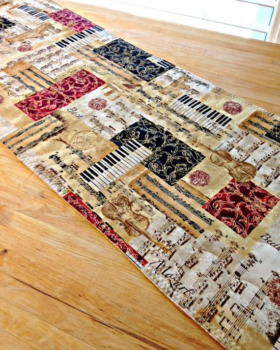 This Quilted Table Runner Features An Elegant Music Themed Print In Shades Of Brown Black