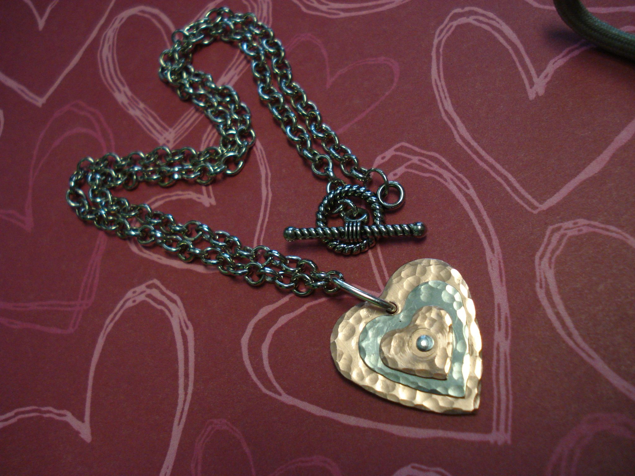 """""""Triple Hearted"""" hand riveted/pounded pendant with chain.    www.chriskoskidesigns.com"""