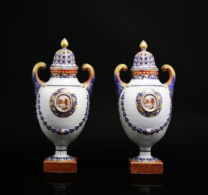 - pair of chinese export porcelain pistol handled urns with reticulated covers