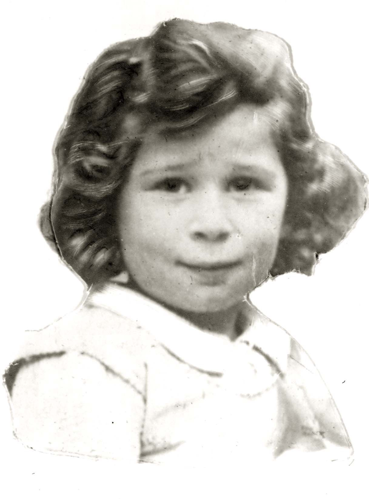 Portrait taken in Argenteuil, France of Evelyne Oliffson with a shy expression at the camera. Evelyne murdered in Auschwitz in 1944 at age 7.