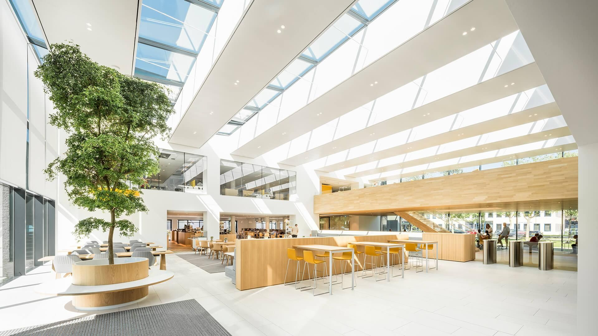 Hofmandujardin Adds Vitality Points To Health Insurer Onvz S Hq Corporate Office Design Commercial Office Design Public Library Design