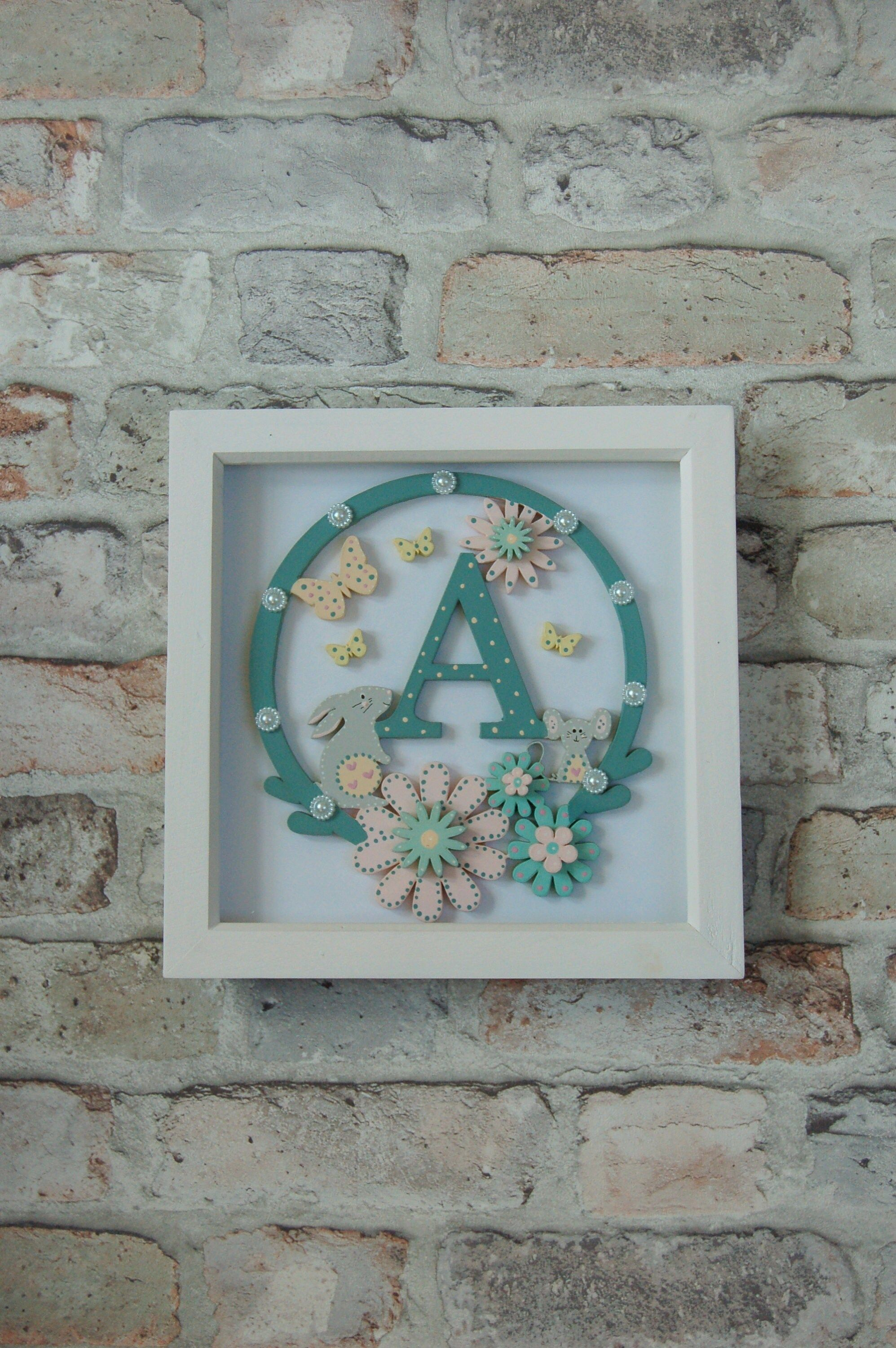 """""""Personalised Baby Wooden Letter in Frame Price is for ONE Frame PRODUCT DESCRIPTION Beautiful White Wooden Box Frame with precision laser cut wooden letter art inside designed by us. The design features a cute Bunny, Mouse and Floral Hoop. The wooden picture has been hand painted with great care and includes a mix of teal, pink and aqua. This is a lovely gift that can be treasured forever. Ideal as a New Baby, Christening, 1st Birthday or Special Occasion Gift. SIZE/ MEASUREMENTS The White Wood"""